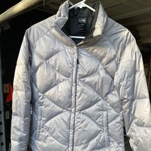Women's silver/grey North Face Puffy winter jacket